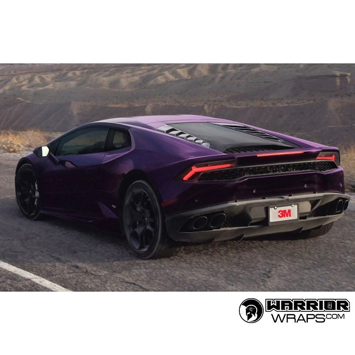 Lamborghini Huracan wrapped in Gloss Wicked Purple vinyl
