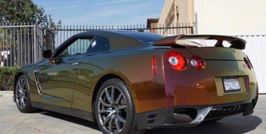 Nissan GTR wrapped in Avery ColorFlow Satin Rising Sun Red/Gold shade shifting vinyl with 3M 8518 Gloss overlaminate