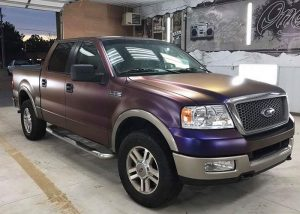 Ford F150 wrapped in Avery ColorFlow Satin Roaring Thunder Blue/Red shade shifting vinyl