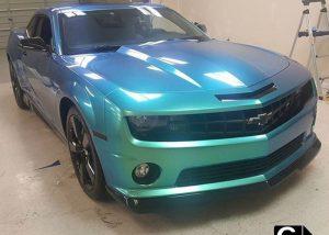 Chevrolet Camaro wrapped in Orafol Shift Effect Gloss Aquamarine shade shifting vinyl