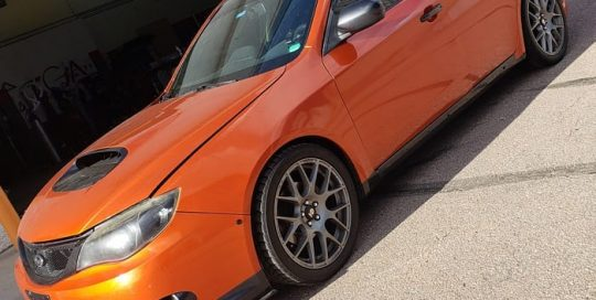 Subaru wrapped in Gloss Fiery Orange vinyl