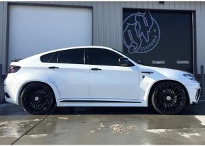 BMW X6M wrapped in Gloss White vinyl