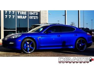 Porsche Panamera wrapped in Gloss Blue Raspberry vinyl