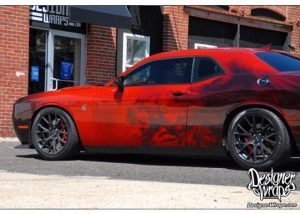 Dodge Challenger Hellcat wrapped in custom printed 3M 1080 Gloss Dragon Fire Red vinyl