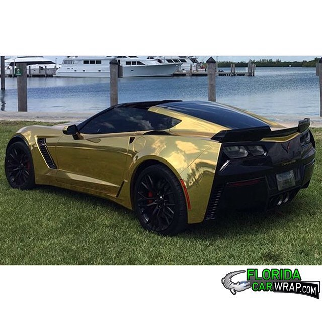 Chevy Corvette wrapped in Avery SW Gold Chrome vinyl