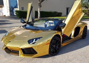 Lamborghini Aventador wrapped in Avery SW Gold Chrome vinyl