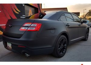 Ford Taurus wrapped in Matte Deep Black vinyl