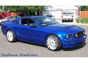 Mustang wrapped in Gloss Cosmic Blue vinyl