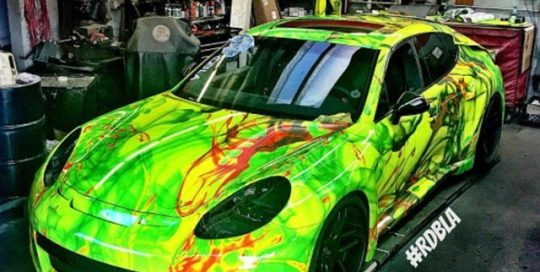 Porsche Panamera wrapped in custom printed 3M 1080 Satin Fluorescent Neon Yellow vinyl