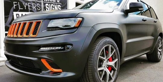 Jeep GrandCherokee SRT8 wrapped in Avery SW Satin Black and 3M 1080 Gloss Burnt Orange vinyls