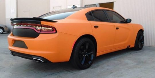Dodge Charger wrapped in Avery SW Matte Orange vinyl