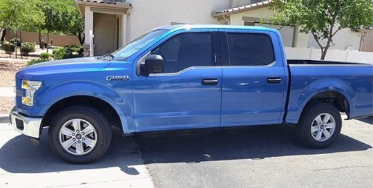 Ford F150 wrapped in Orafol 970RA Night Blue Metallic vinyl