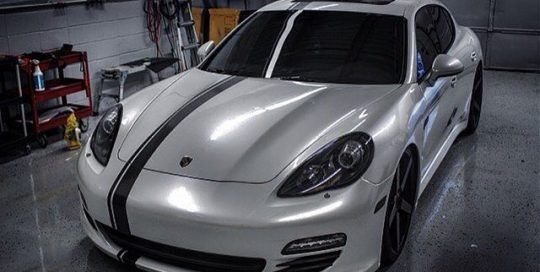 Porsche Panamera wrapped in Avery Gloss Pearl White vinyl