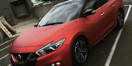 Nissan Maxima wrapped in Arlon UPP Red Aluminum vinyl