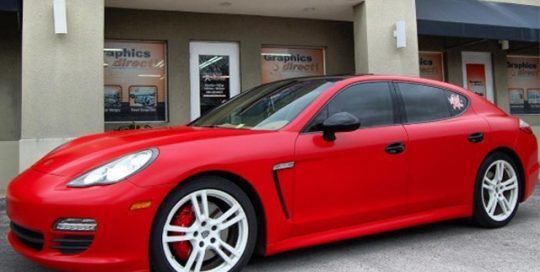 Porsche Panamera wrapped in Avery SW Satin Carmine Red vinyl