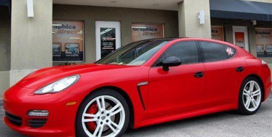Porsche Panamera wrapped in Avery SW Satin Carmine Red vinyl