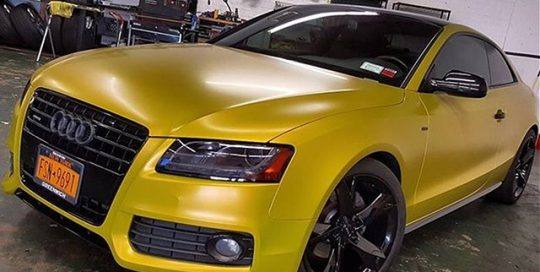 Audi A5 wrapped in Satin Bitter Yellow vinyl