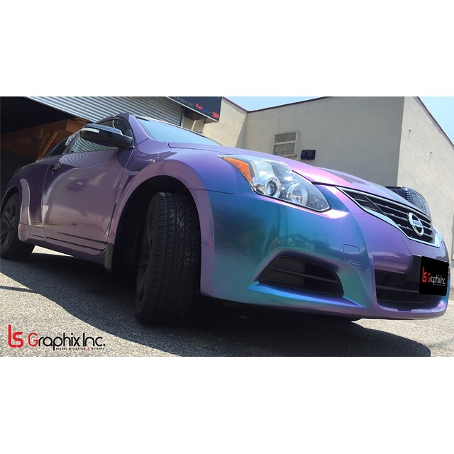 Nissan Altima wrapped in Orafol 970RA Shift Effect Gloss Turquoise/Lavender vinyl