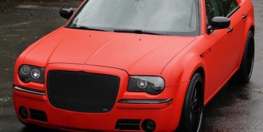 Chrysler 300 wrapped in Matte Red and Brushed Black vinyls