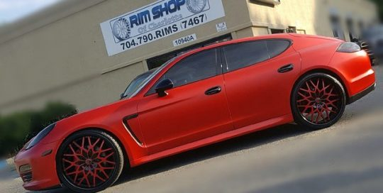 Porsche Panamera wrapped in Matte Red vinyl