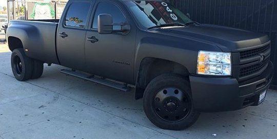 Chevy Silverado Dually wrapped in Matte Deep Black vinyl