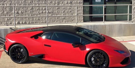 Huracan wrapped in Avery SW Satin Red Carmine and Satin Black vinyls