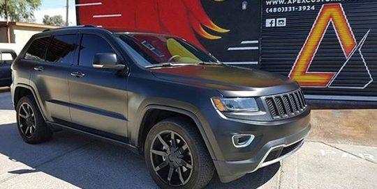 Jeep GrandCherokee wrapped in Satin Black vinyl