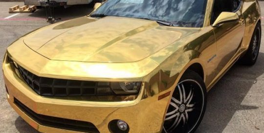 Chevy Camaro wrapped in Avery SW Gold Chrome vinyl
