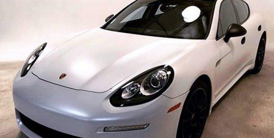 Porsche Panamera wrapped in Avery SW Satin Pearl White vinyl