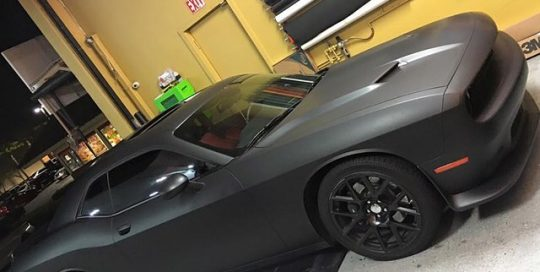 Dodge Challenger wrapped in Matte Deep Black vinyl