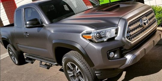 Toyota Tacoma wrapped in Matte Dark Grey vinyl