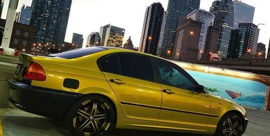 BMW 325i wrapped in Gloss Lemon Sting vinyl