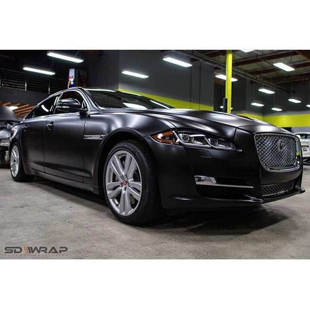 Jaguar XJL wrapped in Satin Black vinyl