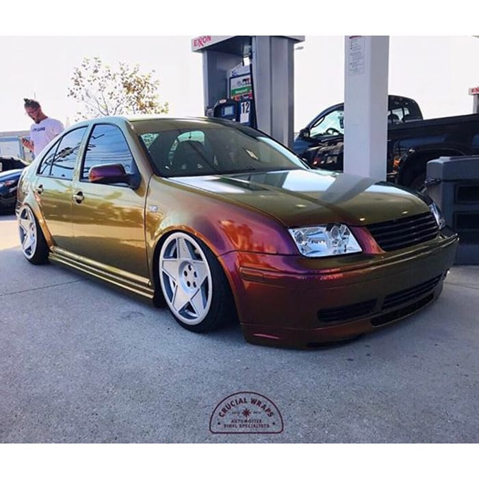 VW Jetta wrapped in Avery ColorFlow Gloss Rising Sun Red/Gold shade shifting vinyl