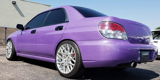Subaru wrapped in Avery SW900 Gloss Diamond Purple vinyl
