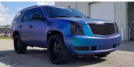 Cadillac wrapped in Orafol 970RA Matte Ultra Marine Violet shade shifting vinyl