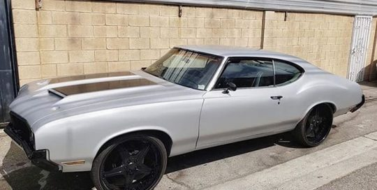 Cutlass wrapped in 3M 1080 Satin White Aluminum and Gloss Black vinyls