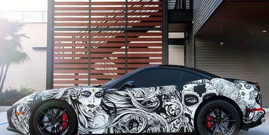 Ferrari wrapped in custom printed 3M 1080 Matte Deep Black vinyl