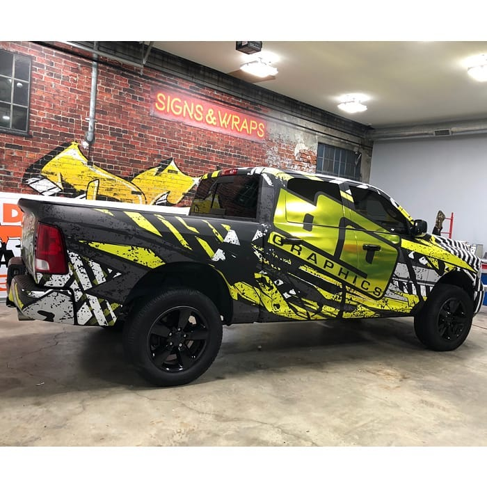 Dodge wrapped in custom printed Avery 1105ezrs vinyl with 1380z Matte overlaminate and Avery Silver Chrome laminated with Orafol 8300 Brimstone Yellow