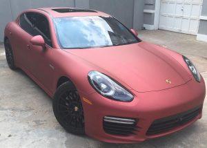 Porsche wrapped in Satin Red Aluminum vinyl