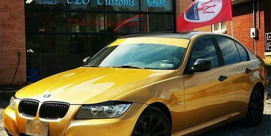 Bmw wrapped in 3M 1080 Gloss Gold Metallic vinyl