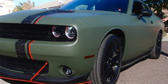 Dodge wrapped in 3M 1080 Matte Military Green and the stripe in 3M 1080 Shadow Black vinyl