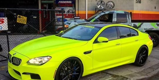 Bmw wrapped in 3M Satin Neon Fluorescent Yellow vinyl