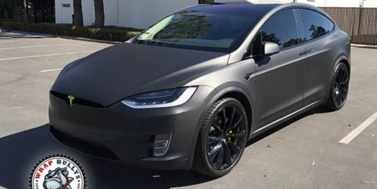 Tesla 3 wrapped in 3M 1080 Matte Deep Black vinyl