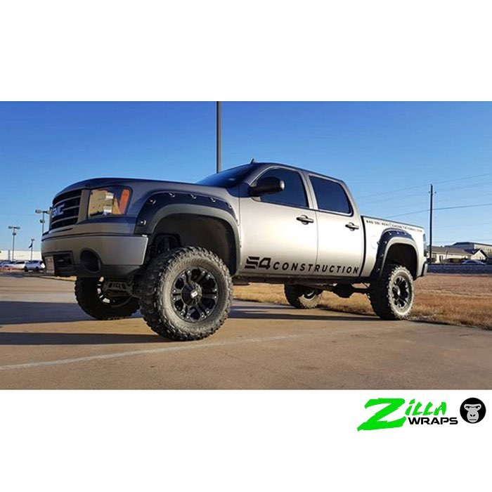 Gmc Sierra wrapped in 3M 1080 Matte Dark Gray and Gloss Black vinyls
