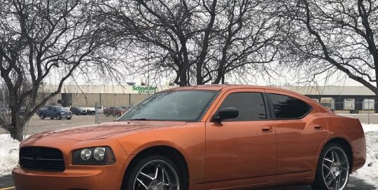 Dodge Charger wrapped in 3M 1080 Gloss Liquid Copper vinyl