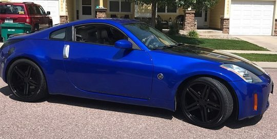 Nissan 350z wrapped in 3M 1080 Gloss Blue Raspberry vinyl