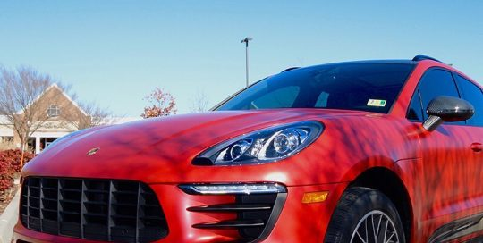 Porsche Macan wrapped in 3M 1080 Satin Smoldering Red vinyl