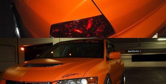 Mitsubishi Evo8 wrapped in Avery SW Matte Orange vinyl