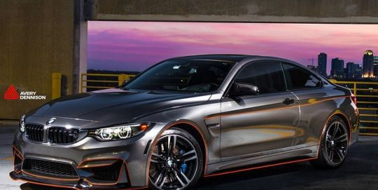 Bmw M4 wrapped in Avery SW Black Chrome and 1200 Reflective Orange vinyls